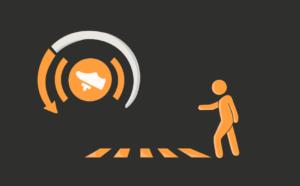 In diesem Bild sieht man die beiden Visualisierungen, die im Head-Up-Display der Fahrzeuge erscheinen, wenn das Wearble betätigt wurde. Das Bremssymbol ist angelehnt an den Warnhinweis der Handbremse und befindet sich innerhalb eines angedeuteten Tachometers. Außerdem ist ein Zebrastreifen zu sehen, an dem eine Figur steht, die einen Schritt nach vorne macht und einen Arm ausstreckt.